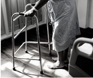 Elderly parent in a care home with walking frame